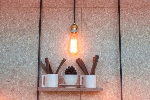 Vintage lighting decorated on brown background, stock photo