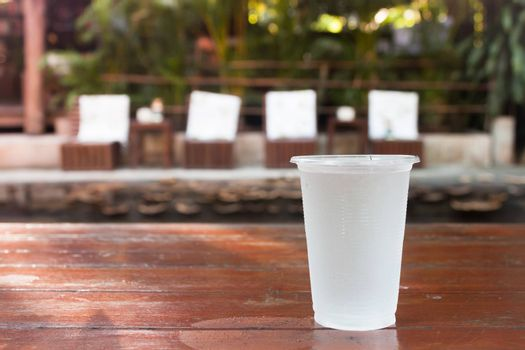 Glass of water on wooden table, stock photo
