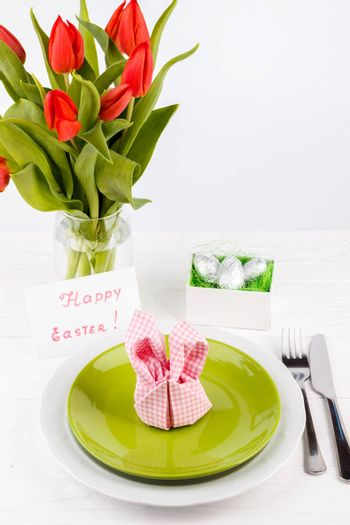 Easter table setting on white wooden table