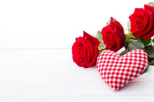 Red roses and fabric heart
