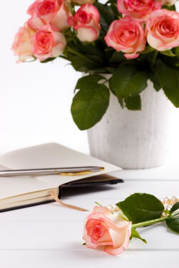 Notepad and pink roses