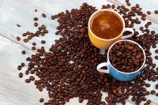 Coffee cup with roasted beans