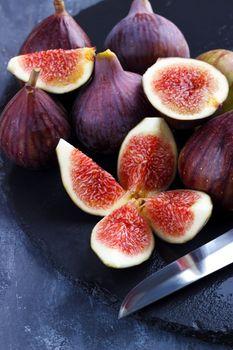 Ripe figs on cutting board