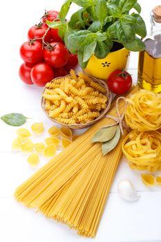 Italian food pasta ingredients,basil,tomato,olive oil on white w