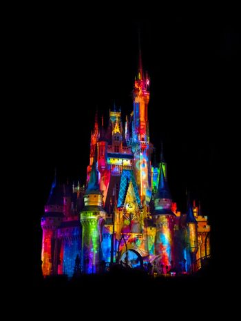 Disney castle beautifully lit with colors
