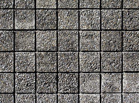 square facade of fine gravel