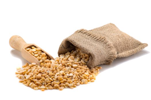 Yellow peas in a burlap with a shovel
