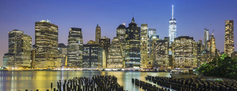 View of New York City Manhattan downtown skyline at dusk, USA.