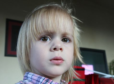 Portrait of cute young  girl with blond  hair