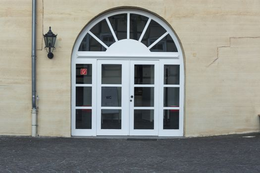 Large round arch door with rungs