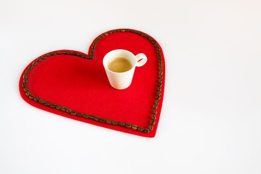 Cup of coffee on a red felt heart