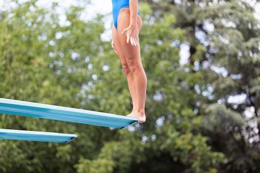 Female diver standing on a springboard