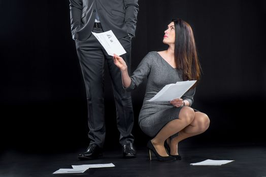 Businesswoman with dropped documents