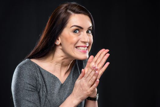 Scheming woman rubbing her hands