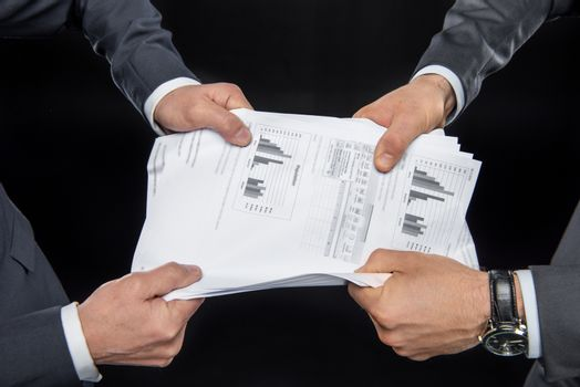 Businesspeople fighting for documents