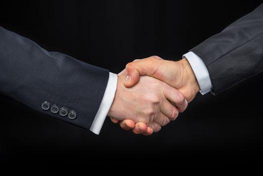 Businespeople shaking hands