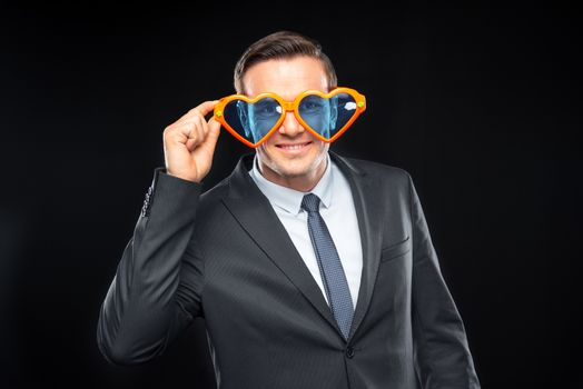 Man in heart shaped glasses