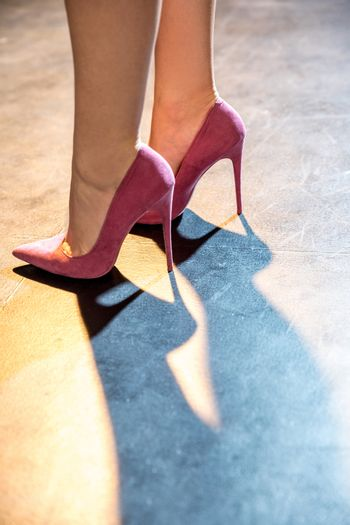 Female legs in pink shoes