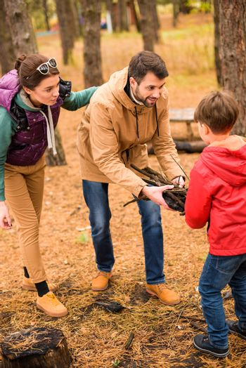Happy family collecting firewood
