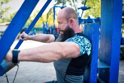 Man training on chest press equipment