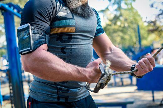 Muscular man exercising outdoors