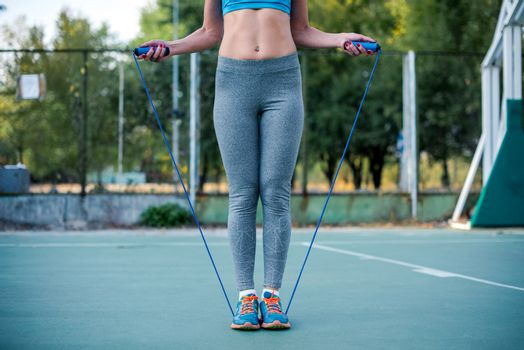 Woman exercising with jump rope