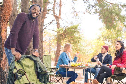 Smiling friends having fun in campsite