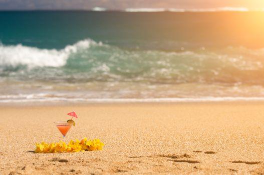 Tropical Drink and Lei on a Sandy Beach Shoreline.