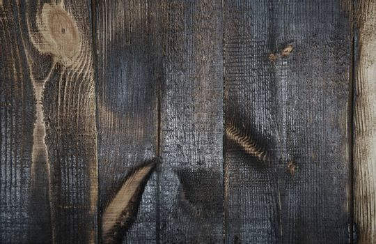 Burnt out wooden plans. Full frame photo