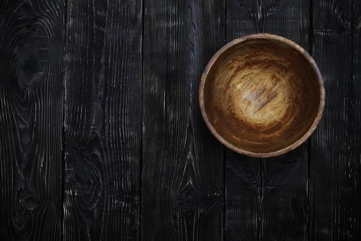 Empty wooden bowl on a vintage table