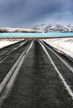 Road along frozen lake