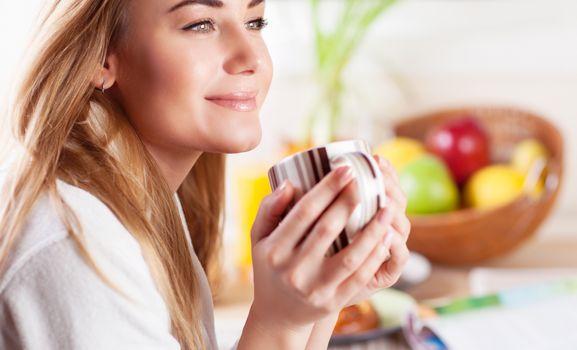 Cute female having coffee