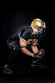 American football player crouching