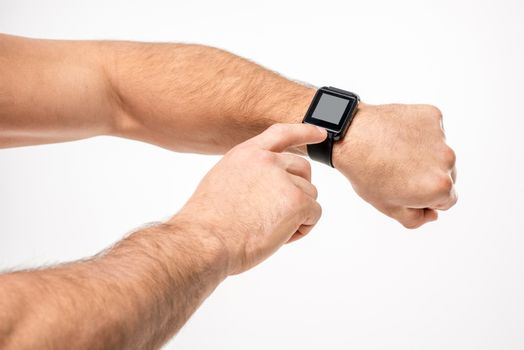 Man pointing on smartwatch