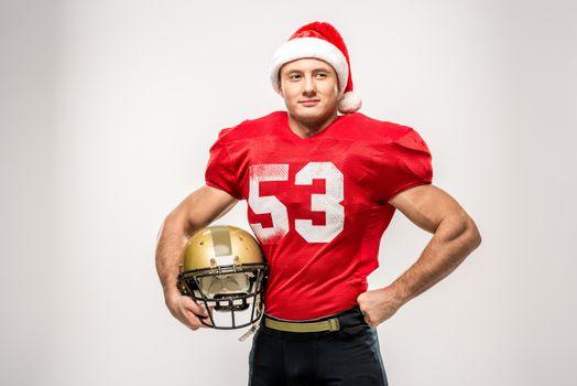 Football player in santa hat