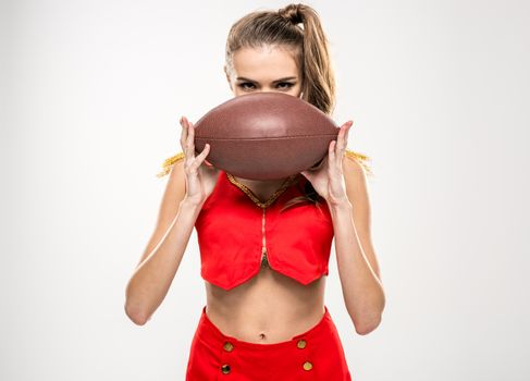 Female cheerleader with rugby ball