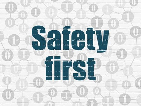 Protection concept: Safety First on wall background