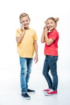 Kids talking on mobile phones