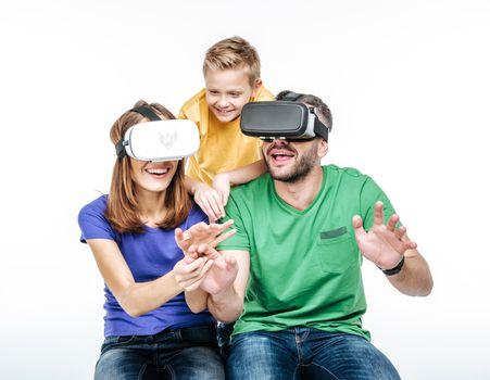 Family using virtual reality headsets