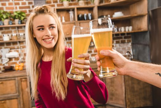 Woman toasting with beer