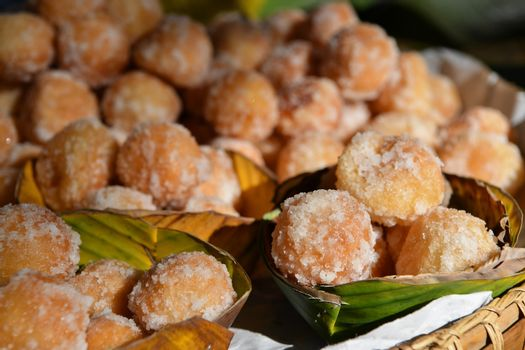 Candy Akehgss, Thai traditional dessert. A dessert made of fried dough, filling made with steamed green beans sautéed with pepper, tumble dry brown circular.