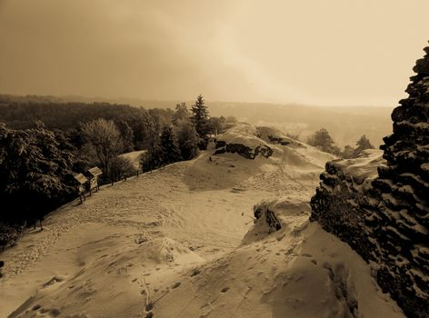 the extraordinary beauty of the winter landscape on top of a hill retro