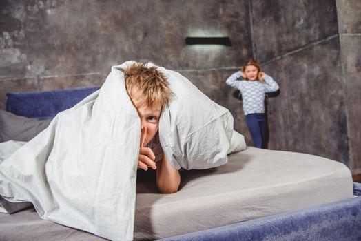 Siblings playing hide and seek