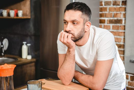 Thoughtful man in kitchen