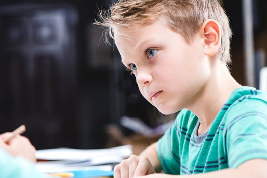 Concentrated schoolchild studying