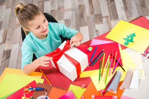 Schoolchild wrapping gift box