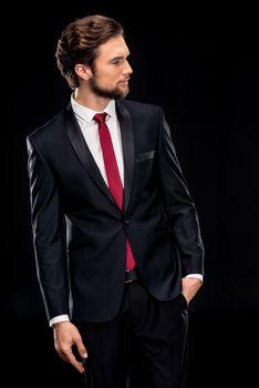 Handsome businessman in black suit