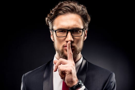 Businessman gesturing for silence