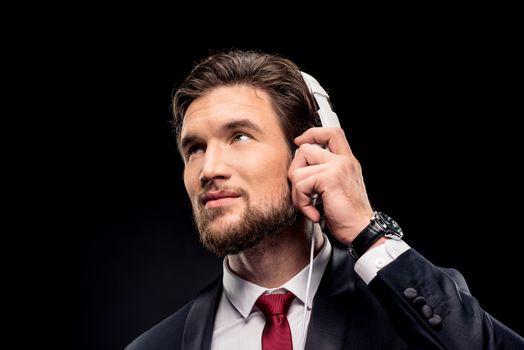 Handsome businessman in headphones