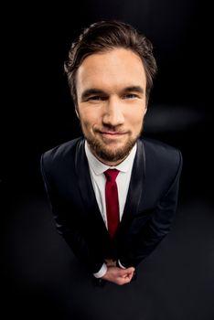 Handsome smiling businessman